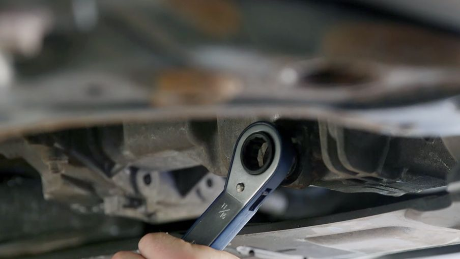 Use the box end wrench to unscrew the drain plug