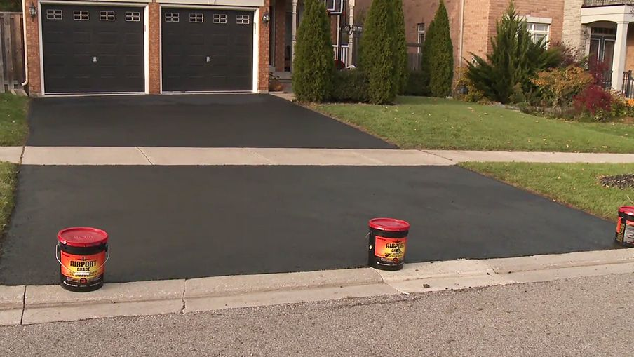 Use empty pails to prevent cars from parking on the fresh sealer