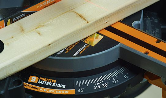 Positive stops on a mitre saw