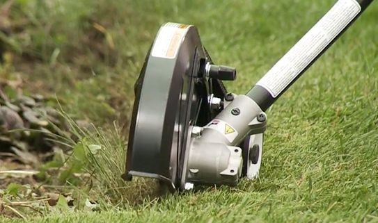 A guard prevents grass from being tossed at you while trimming