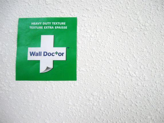 Papier tenture Wall Doctor, texture gravillon Image de l'article