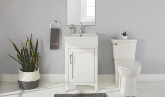 A single sink vanity with one cabinet in a neat bathroom.