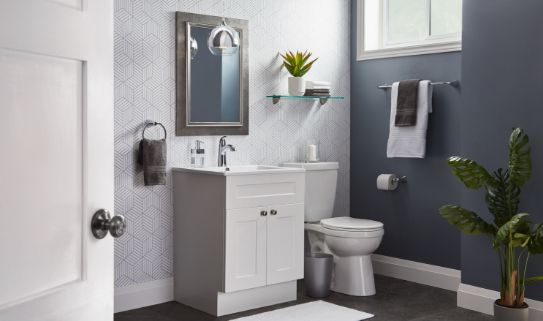 A single sink vanity with laminated finish in a neatly done bathroom.
