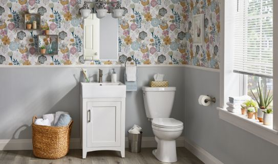 Attractive floral wallpaper on a bathroom wall.