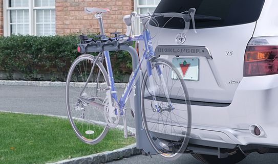 Single mast hitch bike racks