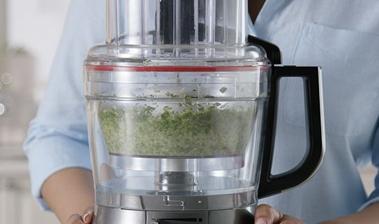 A food processors with an extra work bowl.